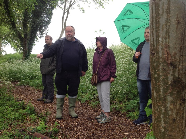 Trevor Tween tells the group about the local wildlife and how it's been managed through the work.